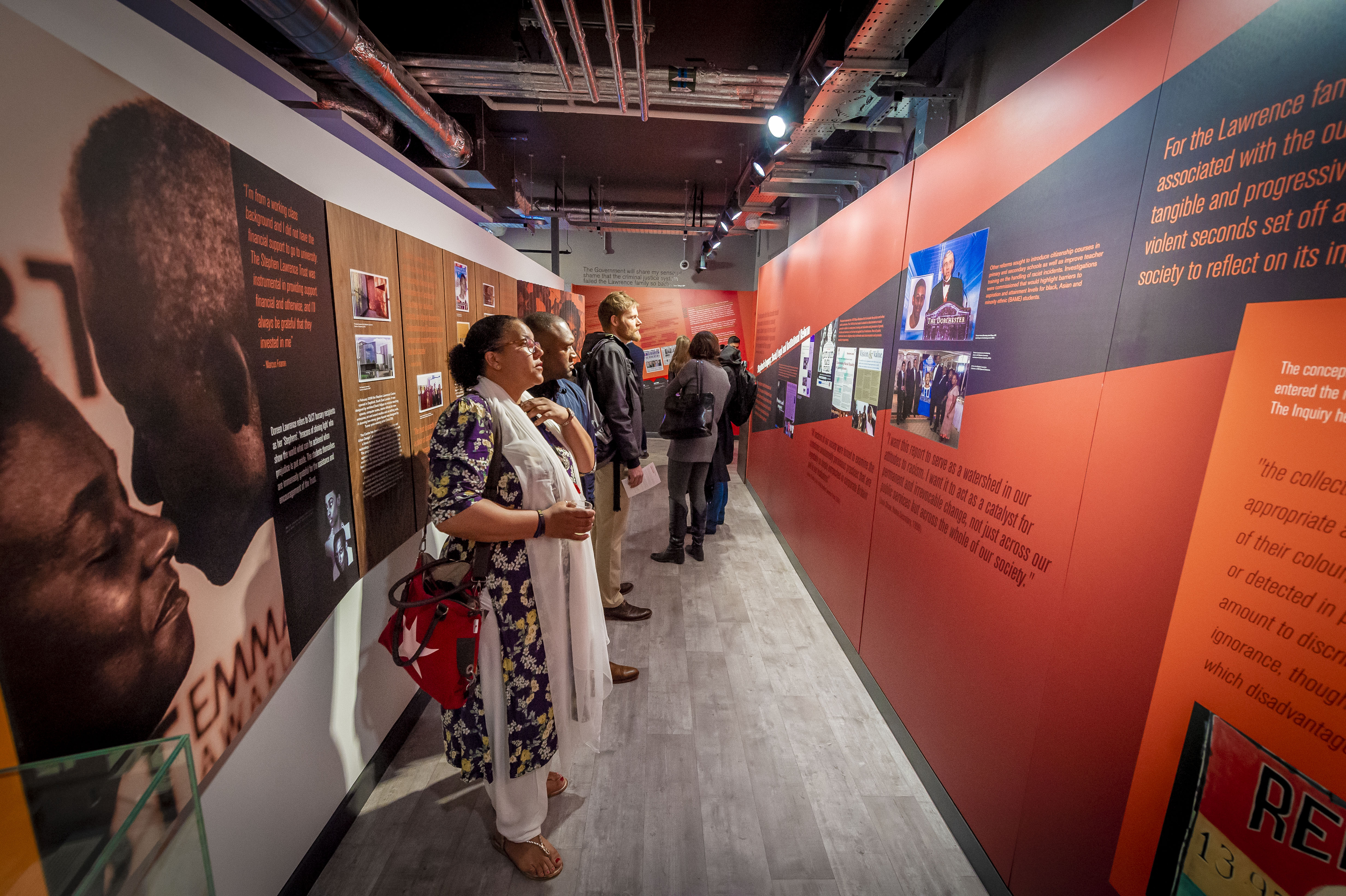 Visitors inside the permanent exhibition at the Stephen Lawrence Research Centre